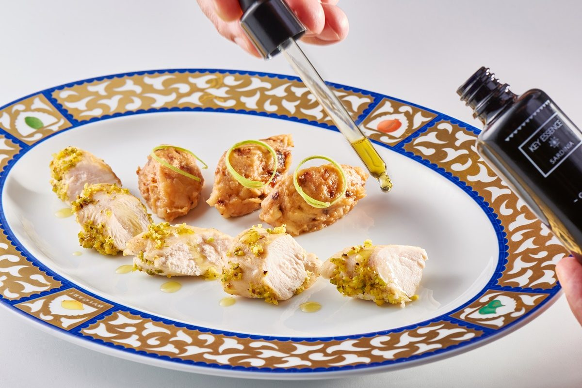 Pistachio crusted chicken breasts with savory quince & green apple compote with grape oil